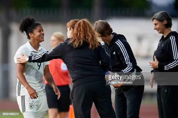Shekiera Martinez from Germany U17 Girls smiles to trainer coach Anouschka Bernhard from Germany during soccer match Lithuania U17 Girls v Germany...