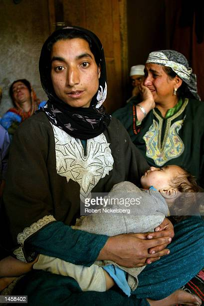 Shekila wife of murdered political party worker Zahoor Ahmed sits with two of her three children and her motherinlaw in their rural house near...