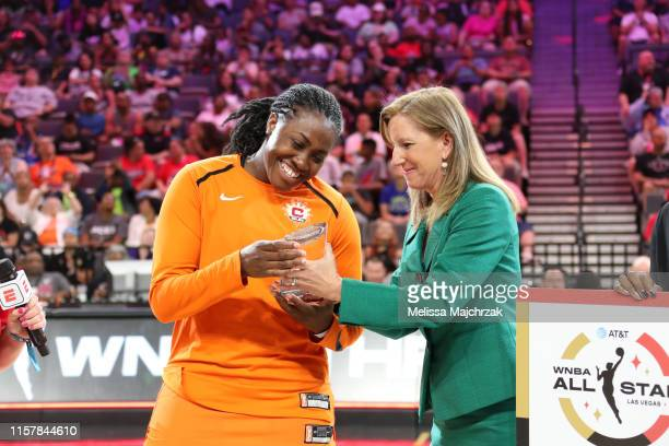 Shekinna Stricklen of the Connecticut Sun accepts the award from WNBA Commissioner Cathy Engelbert after winning the three-point contest during the...