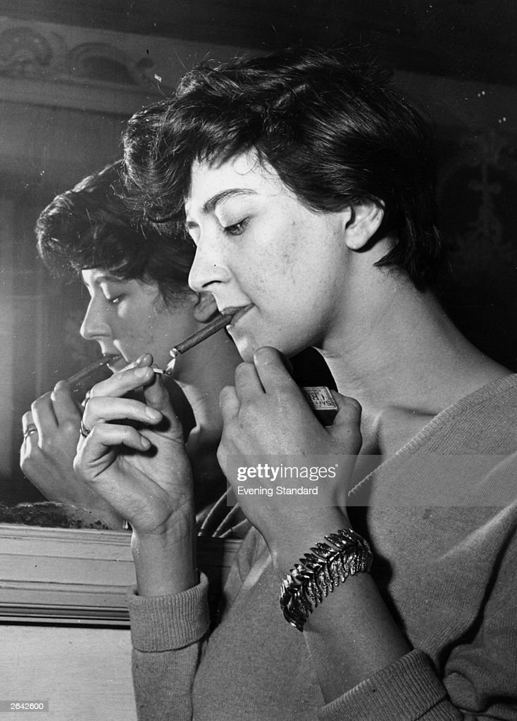 Shelagh Delaney, playwright and author of 'A Taste Of Honey', smoking a cigar.
