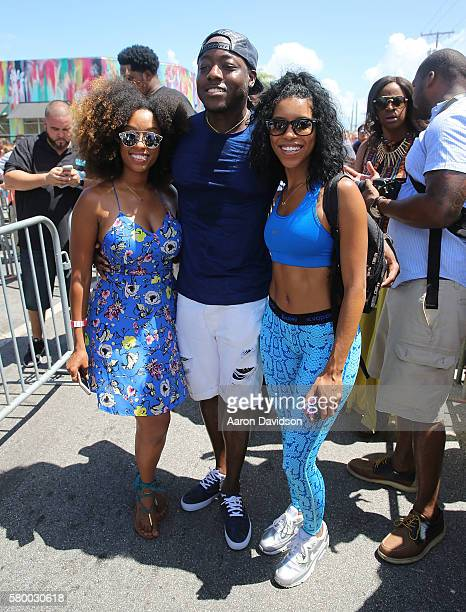 Shelah Marie and Ace Hood attend SUICIDE SQUAD Wynwood Block Party And Mural Reveal With Cast on July 25 2016 in Miami Florida