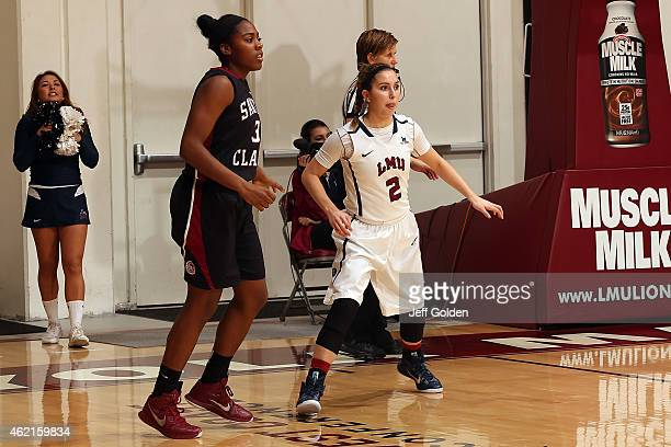 Shelbi Aimonetti of the Loyola Marymount Lions defends against Taylor Berry of the Santa Clara Broncos in the first half at Gersten Pavilion on...