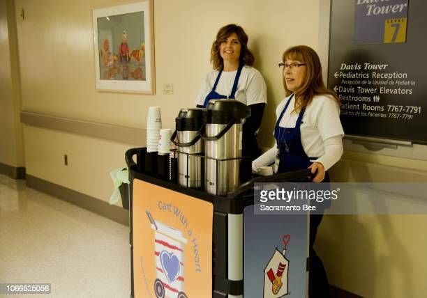 Shelbie Allen left and Terrilyn Salter volunteers with Cart with a Heart part of Ronald McDonald House Charities give out coffee hot chocolate snacks...