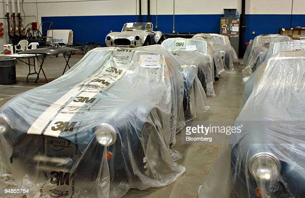 Shelby Cobra vehicles sit under 3M Co. Plastic covers after being painted at the Shelby Automobiles Inc. Factory in Las Vegas, Nevada, U.S., on...