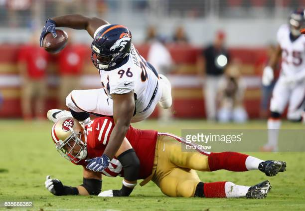 Shelby Harris of the Denver Broncos is tacked by Joe Staley of the San Francisco 49ers after Harris recovered a fumble and was running back with the...