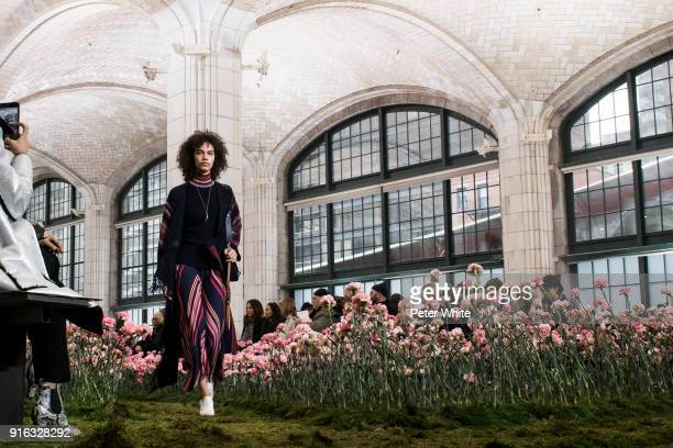 Shelby Hayes walks the runway at the Tory Burch Fall Winter 2018 Fashion Show during New York Fashion Week at Bridge Market on February 9 2018 in New...
