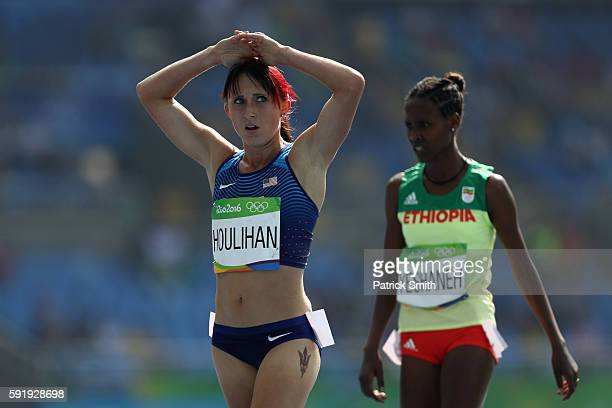 Shelby Houlihan of the United States and Ababel Yeshaneh of Ethiopia are seen during the Women's 5000m Round 1 on Day 11 of the Rio 2016 Olympic...