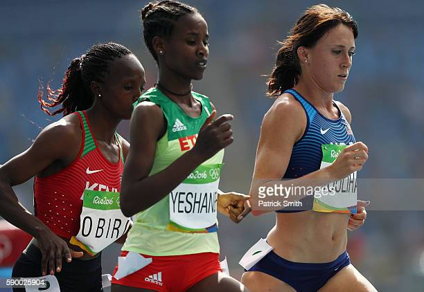 Shelby Houlihan of the United States competes with Ababel Yeshaneh of Ethiopia and Hellen Onsando Obiri of Kenya during the Women's 5000m Round 1 -...