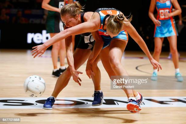 Shelby Miller of the Magpies and Maddie Hay of the Giants compete for a loose ball during the round three Australian Netball League match between the...