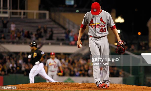 Shelby Miller of the St Louis Cardinals reacts after giving up a solo home run to Pedro Alvarez of the Pittsburgh Pirates in the second inning during...