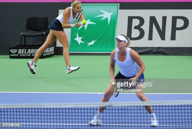 US Shelby Rogers and Coco Vandeweghe react on November 12 2017 in Minsk during their match against Belarus' Aliaksandra Sasnovich and Aryna Sabalenka...