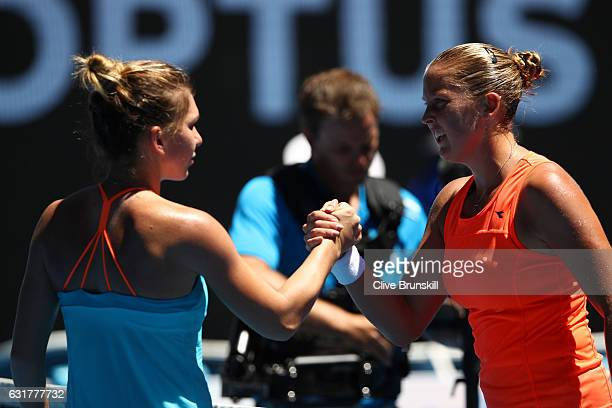 Shelby Rogers of the United States and Simona Halep of Romania shake hands after Rogers won their first round match on day one of the 2017 Australian...