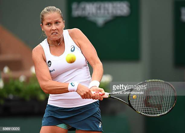 Shelby Rogers of the United States hits a backhand during the Ladies Singles quarter final against Garbine Muguruzu of Spain on day eleven of the...