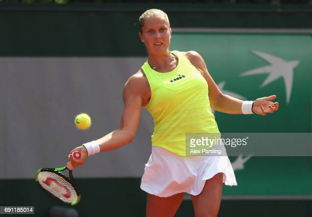 Shelby Rogers of The United States partner of Heather Watson of Great Britain plays a forehand during the ladies doubles first round match against...