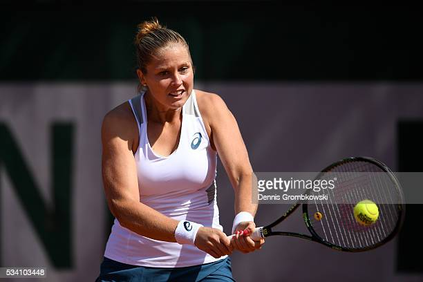 Shelby Rogers of the United States plays a backhand during the Women's Singles second round match against Elena Vesnina of Russia at Roland Garros on...