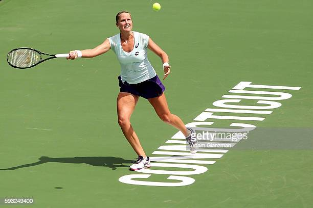 Shelby Rogers of the United States returns a forehand to Kristina Mladenovic of France during the match on day 1 of the Connecticut Open at the...
