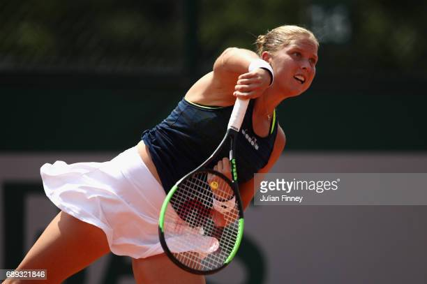 Shelby Rogers of The United States serves during the ladies singles first round match against Marina Erakovic of New Zealand on day one of the 2017...