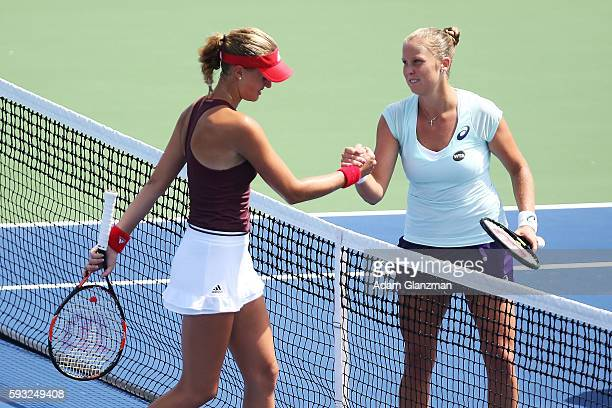 Shelby Rogers of the United States shakes hands with Kristina Mladenovic of France after the match on day 1 of the Connecticut Open at the...