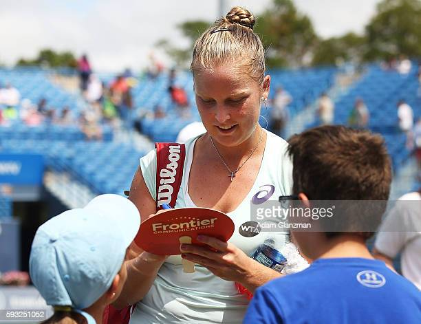 Shelby Rogers of the United States signs autographs after her victory over Kristina Mladenovic of France on day 1 of the Connecticut Open at the...