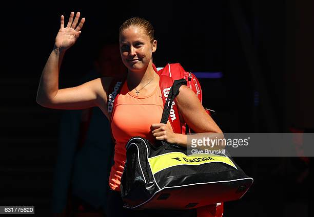 Shelby Rogers of the USA waves as she walks on court for her first round match against Simona Halep of Romaia on day one of the 2017 Australian Open...