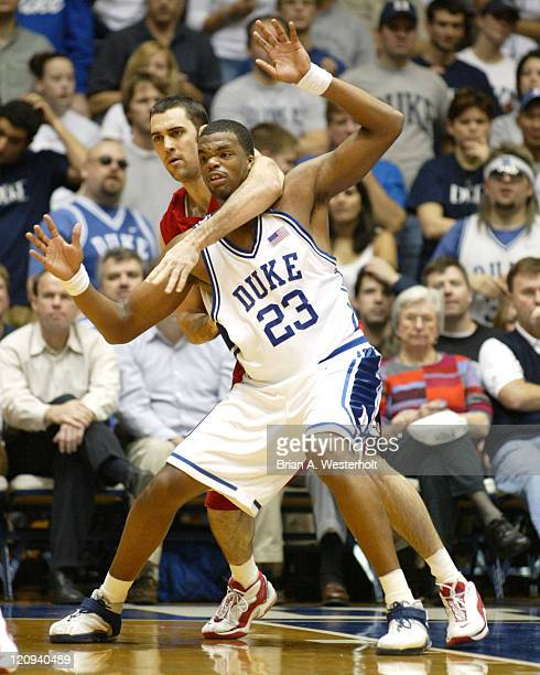Shelden Williams is fouled by Logan Kosmalski during second half action It was Kosmalski's fifth foul of the game