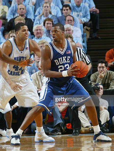 Shelden Williams of Duke Blue Devils posts up Sean May of the North Carolina Tar Heels during the game on February 5 2004 at the Dean Smith Center in...