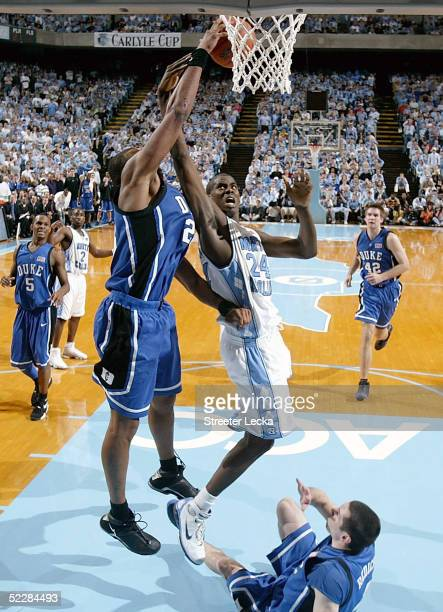 Shelden Williams of the Duke Blue Devils blocks Marvin Williams of the North Carolina Tar Heels on March 6 2005 at the Dean E Smith Center in Chapel...