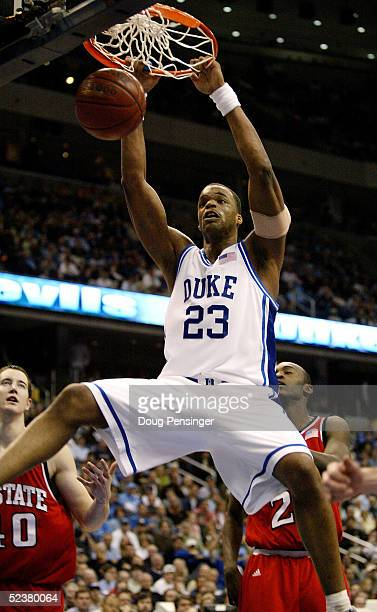 Shelden Williams of the Duke Blue Devils dunks over the North Carolina State Wolfpack during their semi-final ACC Tournament game at the MCI Center...