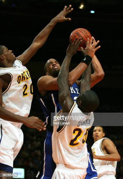 Shelden Williams of the Duke Blue Devils fights to put up a shot over Randy Oveneke and Chaz Crawford of the Drexel Dragons during their Preseason...