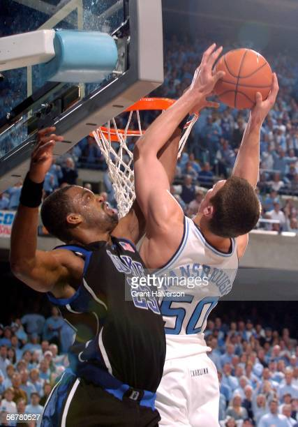 Shelden Williams of the Duke Blue Devils fouls Tyler Hansbrough of the North Carolina Tar Heels during their game on February 7 at the Dean Smith...