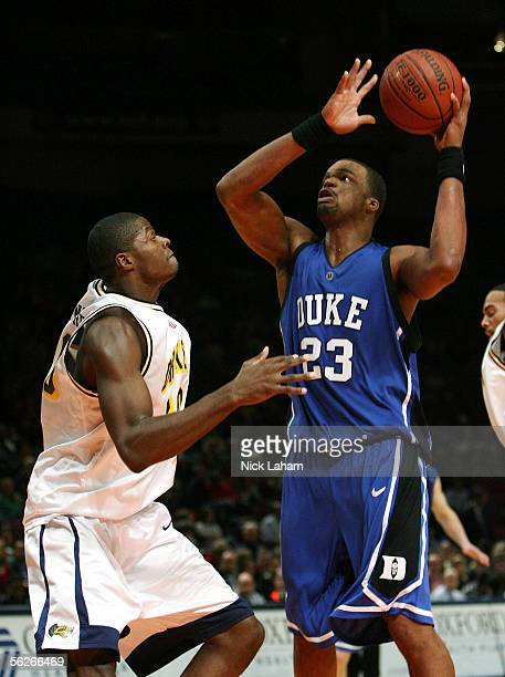 Shelden Williams of the Duke Blue Devils goes up for a shot over Chaz Crawford of the Drexel Dragons during their Preseason NIT game at Madison...