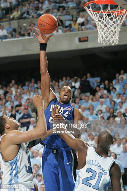 Shelden Williams of the Duke Blue Devils shoots over Sean May and Jawad Williams of the North Carolina Tar Heels during the game on March 6 2005 at...