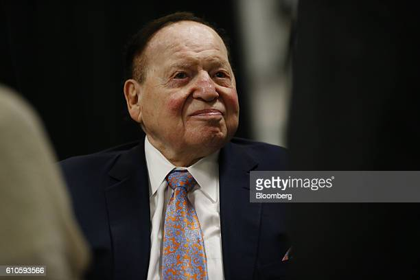 Sheldon Adelson chairman and chief executive officer of Sands China Ltd sits in the audience ahead of the first US presidential debate at Hofstra...