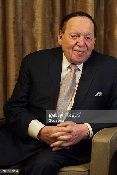 Sheldon Adelson chairman of Sands China Ltd center listens during an interview in Macau China on Friday Dec 18 2015 Casino mogul Adelson acknowledged...