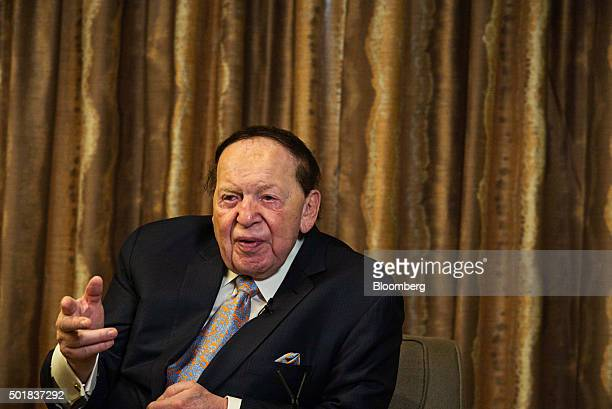 Sheldon Adelson chairman of Sands China Ltd center speaks during an interview in Macau China on Friday Dec 18 2015 Casino mogul Adelson acknowledged...