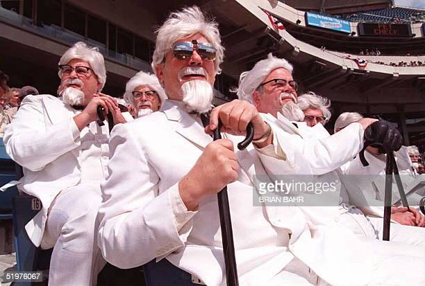 Sheldon Baren and others of a group of 30 men dressed like the late Colonel Harlan Sanders the founder of the Kentucky Fried Chicken fast food chain...