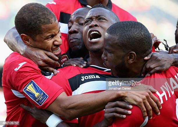 Sheldon Bateau of Trinidad Tobago celebrates a first half goal against Guatemala with teammates including Radanfah Abu Bakr and Khaleem Hyland during...