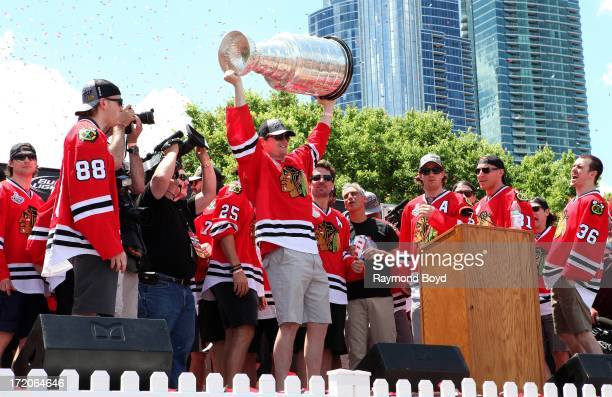 Sheldon Brookbank, defenseman for the Chicago Blackhawks, raises the Stanley Cup Trophy during the Chicago Blackhawks' 2013 Stanley Cup Championship...