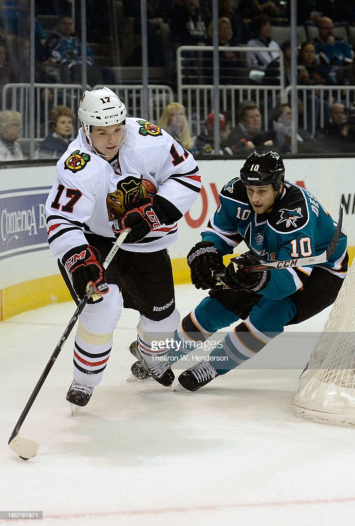 Sheldon Brookbank #17 of the Chicago Blackhawks skates with control of the puck chased by Andrew Desjardins #10 of the San Jose Sharks in the first period of their game at HP Pavilion on February 5, 2013 in San Jose, California. The Blackhawks won the game 5-3.