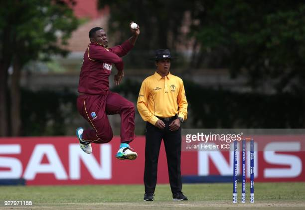 Sheldon Cotterell of The West Indies bowls during The ICC Cricket World Cup Qualifier between The West Indies and The UAE at The Old Hararians Ground...