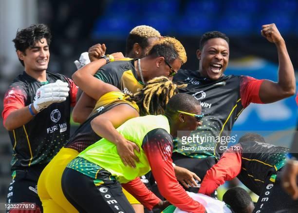 Sheldon Cottrell and Naseem Shah of Saint Kitts & Nevis Patriots celebrate winning the 2021 Hero Caribbean Premier League Final match 33 between...