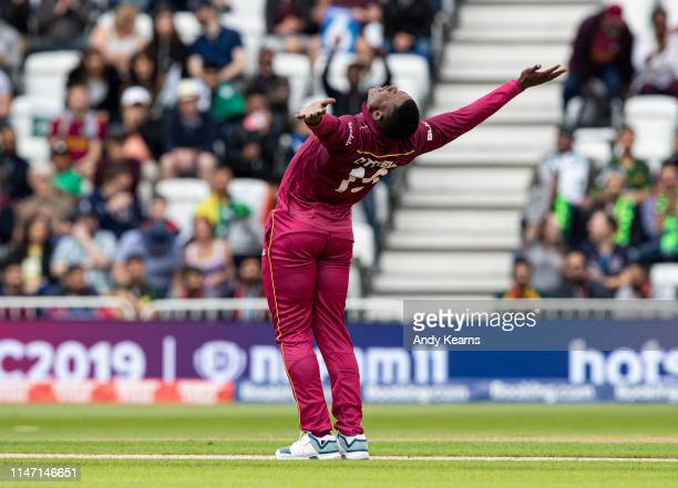 Sheldon Cottrell celebrates taking the wicket of Imam-ul-Haq of Pakistan during the Group Stage match of the ICC Cricket World Cup 2019 between West...