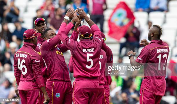 Sheldon Cottrell celebrates with team mates after taking the wicket of ImamulHaq during the Group Stage match of the ICC Cricket World Cup 2019...
