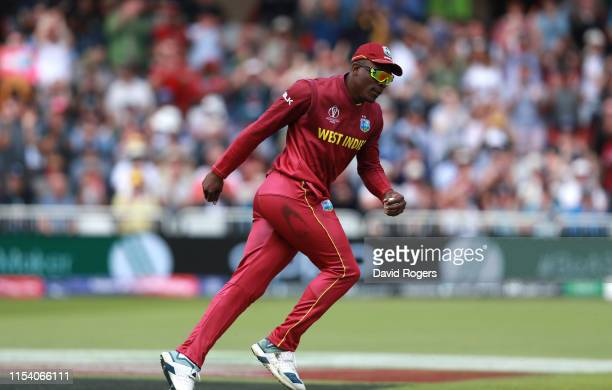 Sheldon Cottrell of the West Indies celebrates after catching out Steve Smith during the Group Stage match of the ICC Cricket World Cup 2019 between...