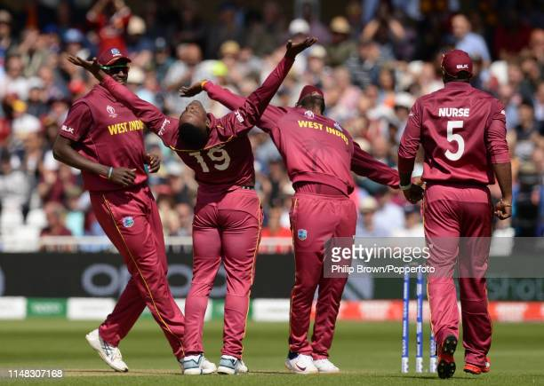 Sheldon Cottrell of the West Indies celebrates after dismissing David Warner of Australia in the pavilion before the ICC Cricket World Cup Group...