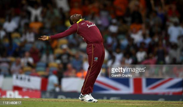 Sheldon Cottrell of the West Indies celebrates dismissing England captain Eoin Morgan during the 2nd One Day International match between the West...