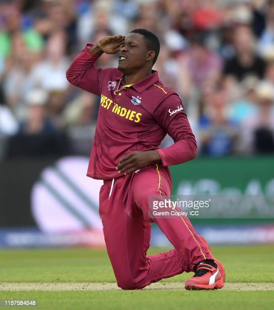 Sheldon Cottrell of the West Indies celebrates running out Colin de Grandhomme of New Zealand during the Group Stage match of the ICC Cricket World...