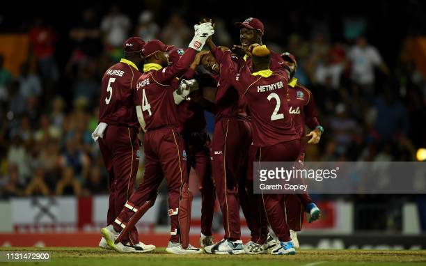 Sheldon Cottrell of the West Indies celebrates with teammates after dismissing Moeen Ali of England during the 2nd One Day International match...