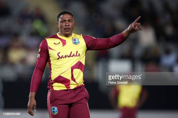 Sheldon Cottrell of the West Indies prepares the field during game one of the International T20 series between New Zealand and the West Indies at...