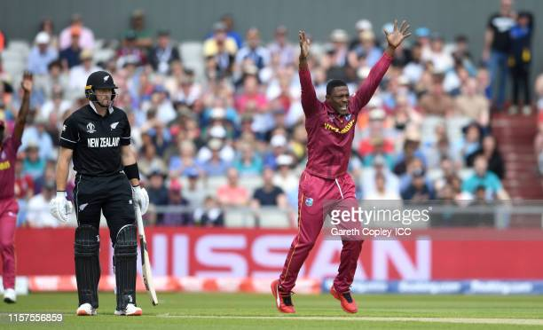 Sheldon Cottrell of the West Indies successfully appeals for the wicket Martin Guptill of New Zealand during the Group Stage match of the ICC Cricket...